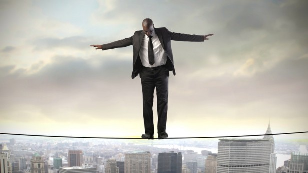 African-American-businessman-walks-tightrope-over-city-via-Shutterstock-615x345